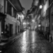 Brunngasse at Rain - Berne by Night in Black And White
