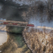 Red Train Crossing Bridge in Winter Landscape - Winter Time