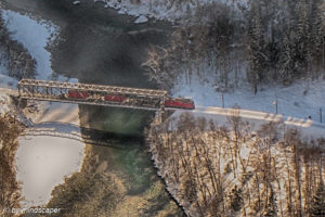 Red Train Crossing Bridge in Winter Landscape - Winter Time
