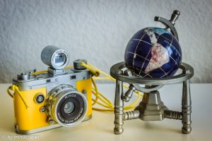 Geotagging: Yellow Vintage Camera And Blue Globe