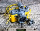 Geotagging: Yellow Vintage Camera With Spirit Level On Old Berne Map