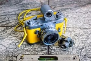 Geotagging: Yellow Vintage Camera With Spirit Level On Old Berne