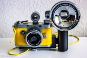 Yellow Vintage Rangefinder Camera With Flash