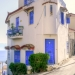 Greek Triangle House with Blue Doors and Windows
