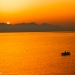Autumny Sunrise with Small Fisherboat at the Mediterranean