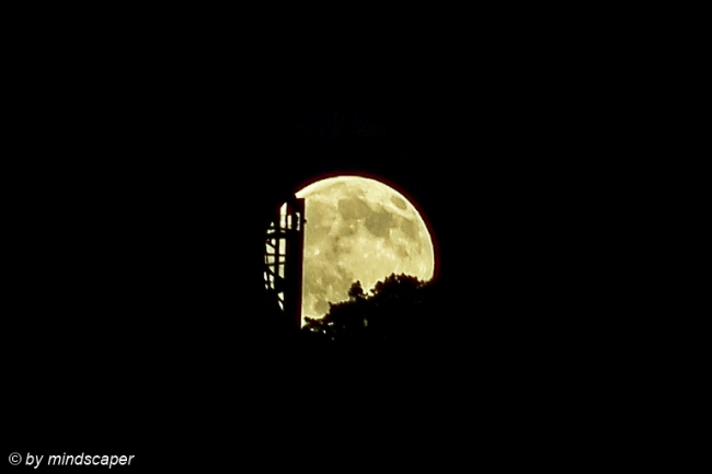 Moonrise Behind Wooden Tower