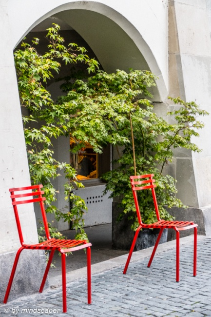 Take a Seat - Red Chairs in Brunngasse