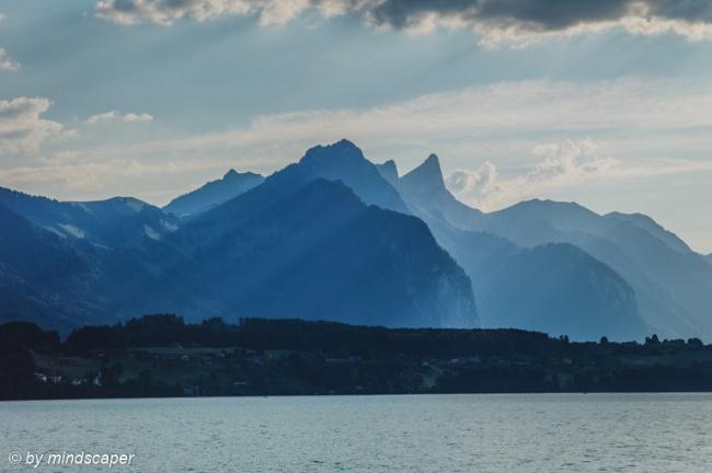 Swiss Alpine Panorama in Berner Oberland seen from Lake Thun