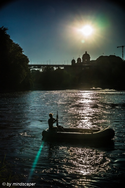 Rubber Boat on Aare at Sunset wirh Bundeshaus