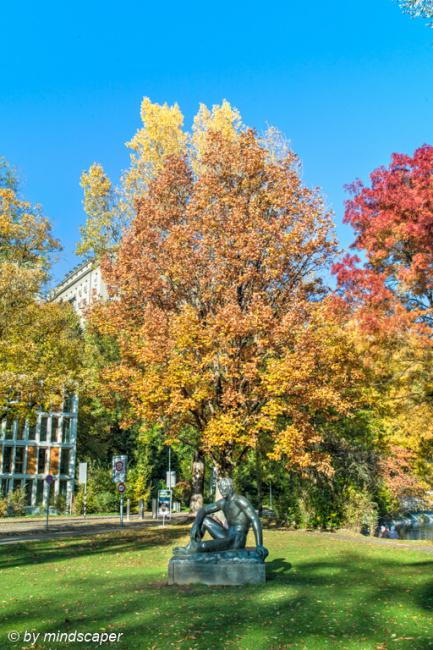 Pan Sculpture with Autumn Tree